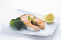Fresh salmon cooked with salad Stock Photos