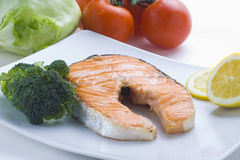 Fresh salmon cooked with salad Royalty Free Stock Photography