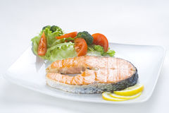 Fresh salmon cooked with salad Royalty Free Stock Photo