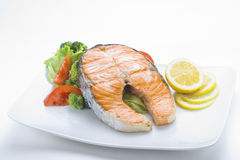 Fresh salmon cooked with salad royalty free stock images