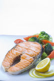 Fresh salmon cooked with salad Royalty Free Stock Photos