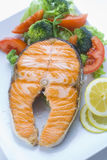 Fresh salmon cooked with salad Stock Image