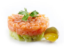 Fresh salmon and cucumber tartare. And raw egg Royalty Free Stock Photography