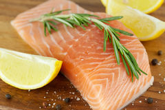 Fresh salmon filet. With spices and herbs stock photography