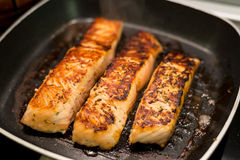 Fresh salmon filles  grilled in a pan Royalty Free Stock Image