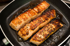 Fresh salmon filles  grilled in a pan Royalty Free Stock Photography