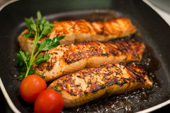Fresh salmon filles  grilled in a pan Stock Photo