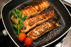 Fresh salmon filles  grilled in a pan Royalty Free Stock Photo