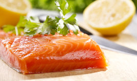Fresh salmon fillet. On wooden board Stock Photography