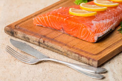 Fresh salmon fillet with aromatic herbs, spices Royalty Free Stock Photo