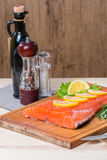 Fresh salmon fillet with aromatic herbs, spices Royalty Free Stock Photography