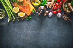 Fresh salmon fillet with aromatic herbs, spices and vegetables. Balanced diet or cooking concept Royalty Free Stock Image