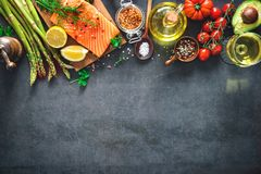 Fresh salmon fillet with aromatic herbs, spices and vegetables Royalty Free Stock Photos