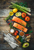 Fresh salmon fillet with aromatic herbs, spices and vegetables Stock Photo