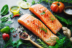 Fresh salmon fillet with aromatic herbs, spices and vegetables Stock Photos