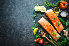 Fresh salmon fillet with aromatic herbs, spices and vegetables Royalty Free Stock Image