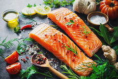 Fresh salmon fillet with aromatic herbs, spices and vegetables Stock Image