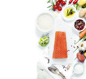 Fresh salmon fillet with aromatic herbs, spices and vegetables Stock Photography