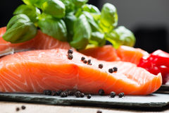 Fresh salmon fillet with basil and pepper close up Stock Photo
