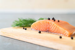 Fresh Salmon Fillet on board. With black peppers Stock Image