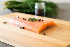 Fresh Salmon Fillet on board. With black peppers Stock Images