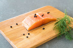 Fresh Salmon Fillet on board. With black peppers Stock Photography