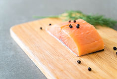 Fresh Salmon Fillet on board. With black peppers Royalty Free Stock Photography