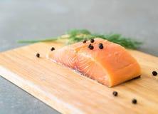 Fresh Salmon Fillet on board Stock Photo