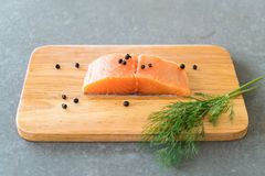 Fresh Salmon Fillet on board Stock Photos