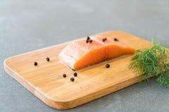 Fresh Salmon Fillet on board Royalty Free Stock Photos