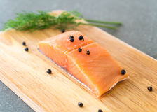 Fresh Salmon Fillet on board. With black peppers Royalty Free Stock Images
