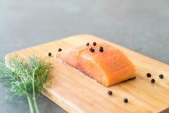 Fresh Salmon Fillet on board Stock Image