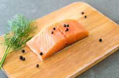 Fresh Salmon Fillet on board. With black peppers Royalty Free Stock Image