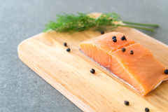 Fresh Salmon Fillet on board. With black peppers Stock Photos