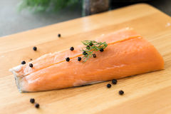 Fresh Salmon Fillet on board. With black peppers Stock Photo