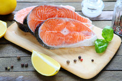 Fresh salmon fillet on a board Royalty Free Stock Photos