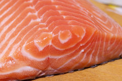 Fresh salmon fillet close up. Fresh salmon fillet salted with coarse sea salt close up Royalty Free Stock Image