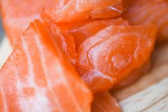 Fresh salmon fillet on cutting board royalty free stock image