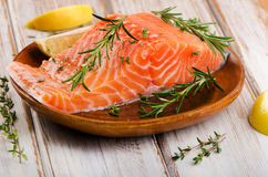 Fresh  salmon fillet on a cutting board. Selective focus Stock Photo