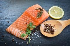 Fresh salmon fillet on dark background royalty free stock images