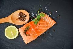 Fresh salmon fillet on dark background stock image