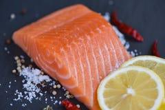 Fresh salmon fillet on dark background stock photos