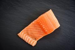 Fresh salmon fillet fish seafood dark background. Fresh salmon fillet fish seafood on dark background stock images