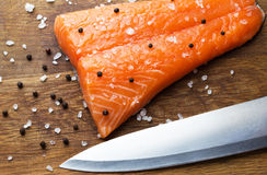 Fresh salmon fillet and knife Royalty Free Stock Image