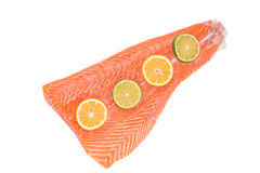 Fresh salmon fillet with lemon. Isolated on a white background Stock Photography