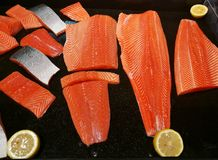 Fresh salmon fillet with lemon in supermarket. Fresh salmon fillet with lemon in the supermarket Stock Photography