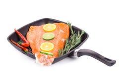 Fresh salmon fillet on a pan. Royalty Free Stock Image