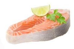Fresh salmon fillet with parsley and lemon slices.  Stock Images