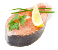 Fresh salmon fillet with parsley and lemon slices.  Stock Photos