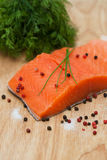 Fresh salmon fillet with sea salt, pink, black pepper Stock Photography